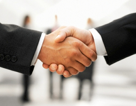 Cheesy photo of a business handshake